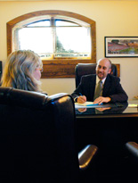 photo-of-attorney-collum-meeting-with-client